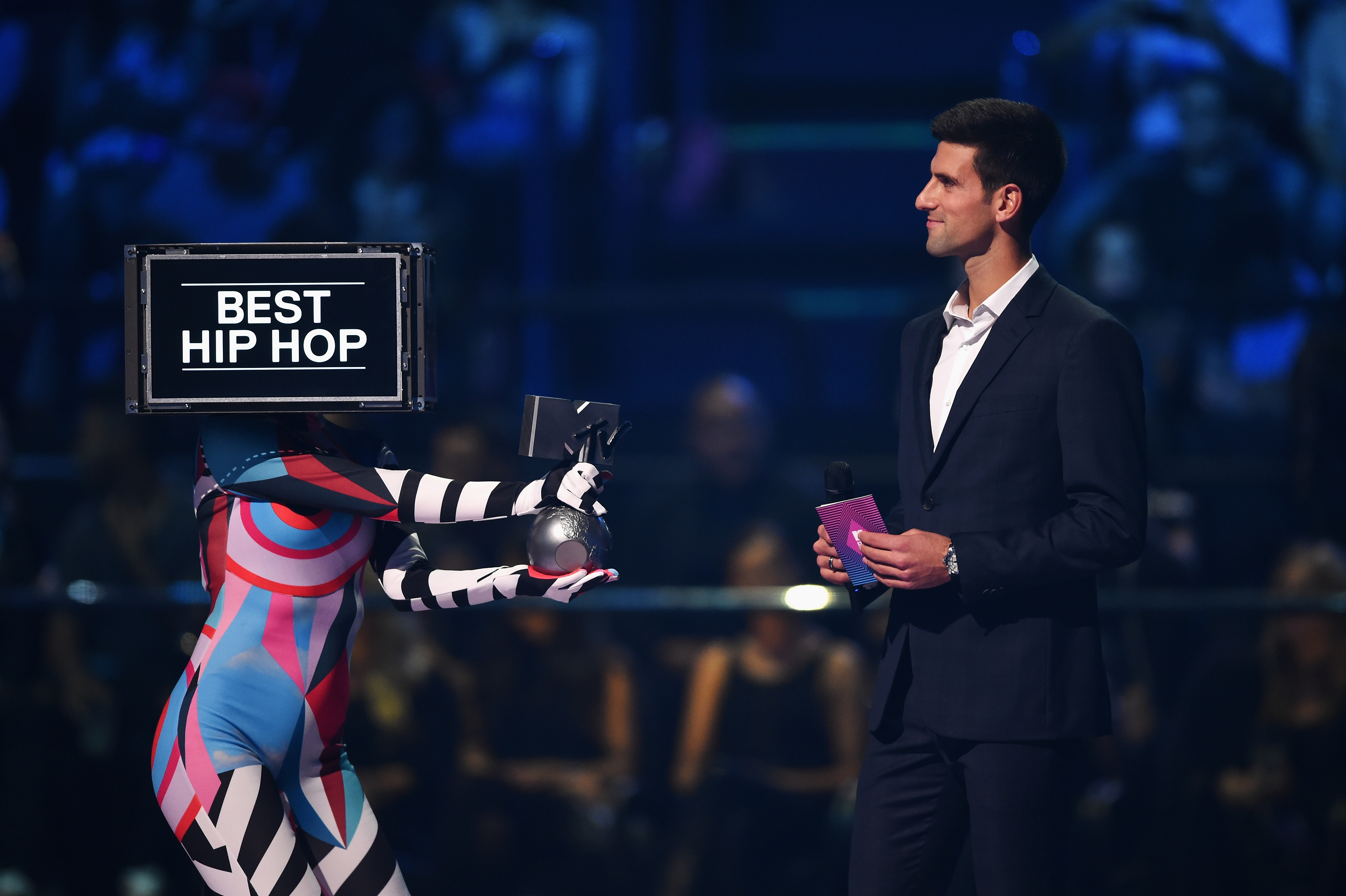 MILAN, ITALY - OCTOBER 25: Tennis pro Novak Djokovic presents best Hip-Hop award on stage during the MTV EMA's 2015 at the Mediolanum Forum on October 25, 2015 in Milan, Italy. (Photo by Brian Rasic/Getty Images for MTV) *** Local Caption *** Novak Djokovic