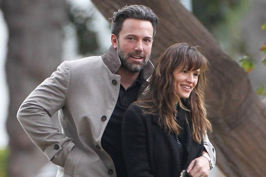"""51605480 Actor Ben Affleck stops to enjoy a cigarette while out and about with his wife Jennifer Garner in Brentwood, California on December 11, 2014. Jennifer recently spoke about her date nights with Ben saying, """"We're boring parents, so we just play with the girls. I'll usually cook a meal for everyone and help them with homework, that's usually our date night."""" FameFlynet, Inc - Beverly Hills, CA, USA - +1 (818) 307-4813"""