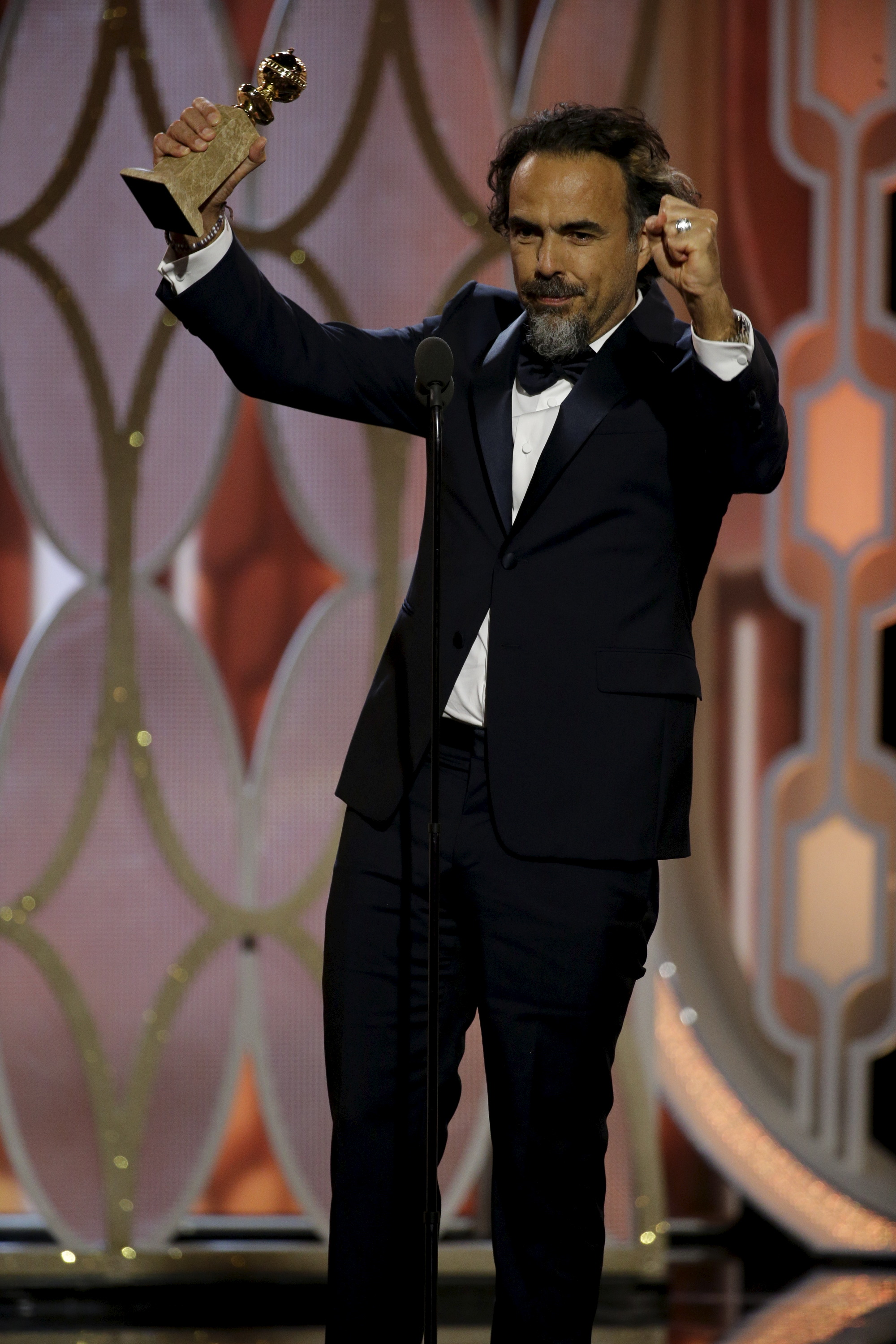 """Alejandro G. Inarritu reacts after winning the Best Director - Motion Picture for """"The Revenant"""", at the 73rd Golden Globe Awards in Beverly Hills, California January 10, 2016.  REUTERS/Paul Drinkwater/NBC Universal/Handout For editorial use only. Additional clearance required for commercial or promotional use. Contact your local office for assistance. Any commercial or promotional use of NBCUniversal content requires NBCUniversal's prior written consent. No book publishing without prior approval. TPX IMAGES OF THE DAY      - RTX21S9P"""