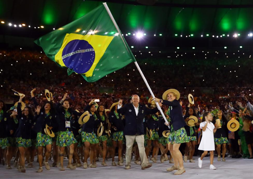 Flagbearer Yane Marques of Brazil leads her country's contingent. REUTERS/Kai Pfaffenbach