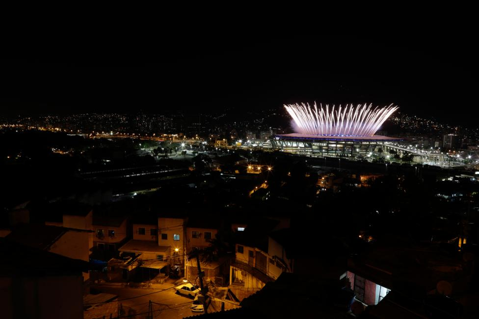 The Maracana Olympic Stadium during the opening ceremony is seen from the Mangueira favela slum. REUTERS/Ricardo Moraes