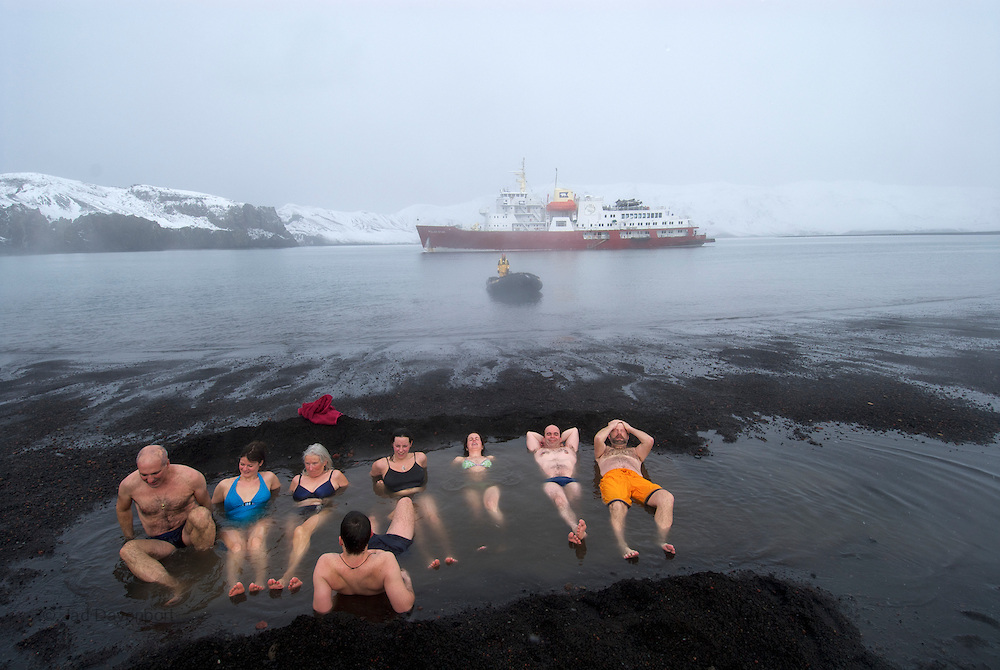 Passengers from the MV Polar Star, an expedition cruise ship, bathing in the thermal vents at Deception Island, a dormant caldera.